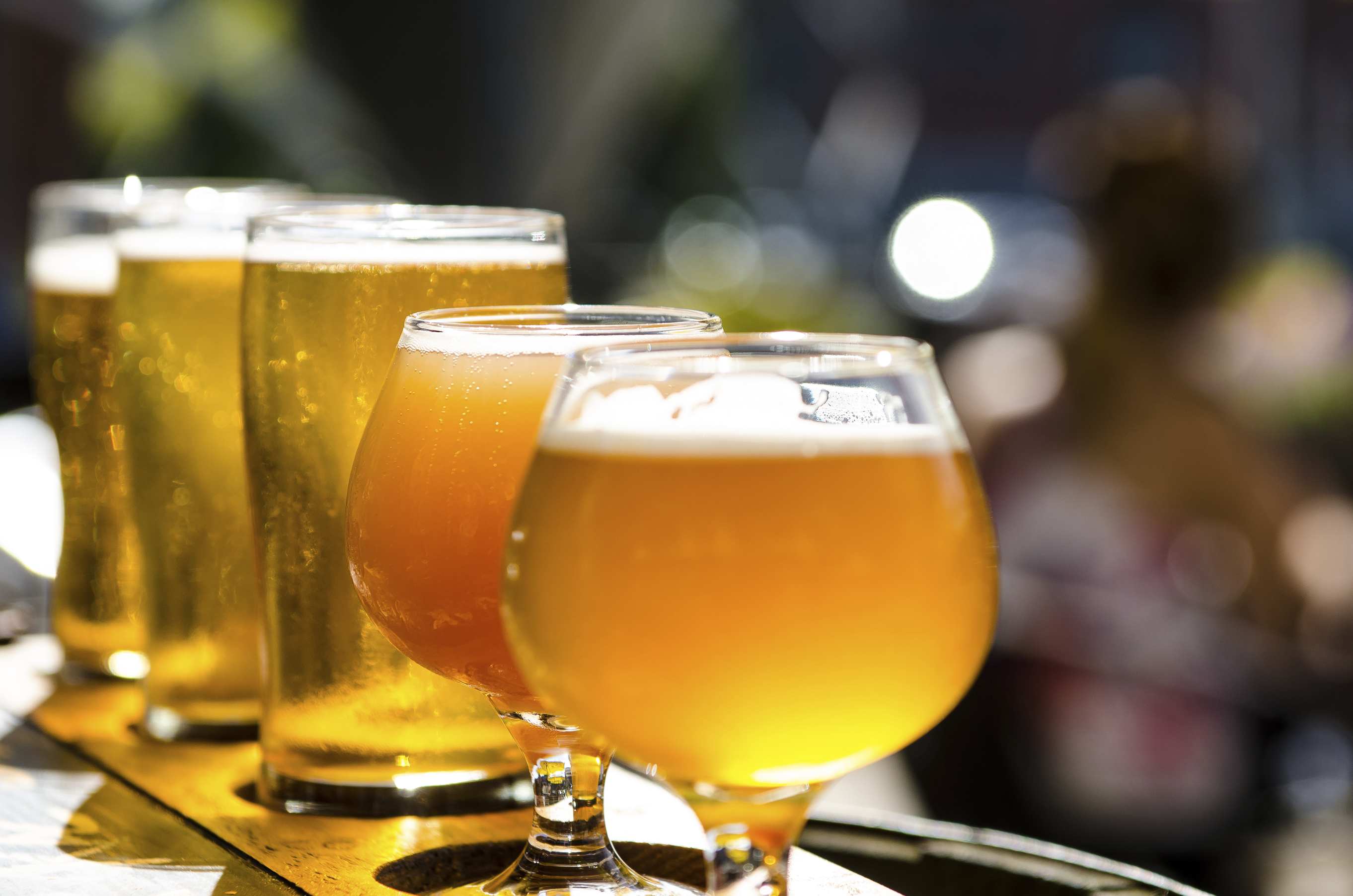 image of many beer glasses filled with beer