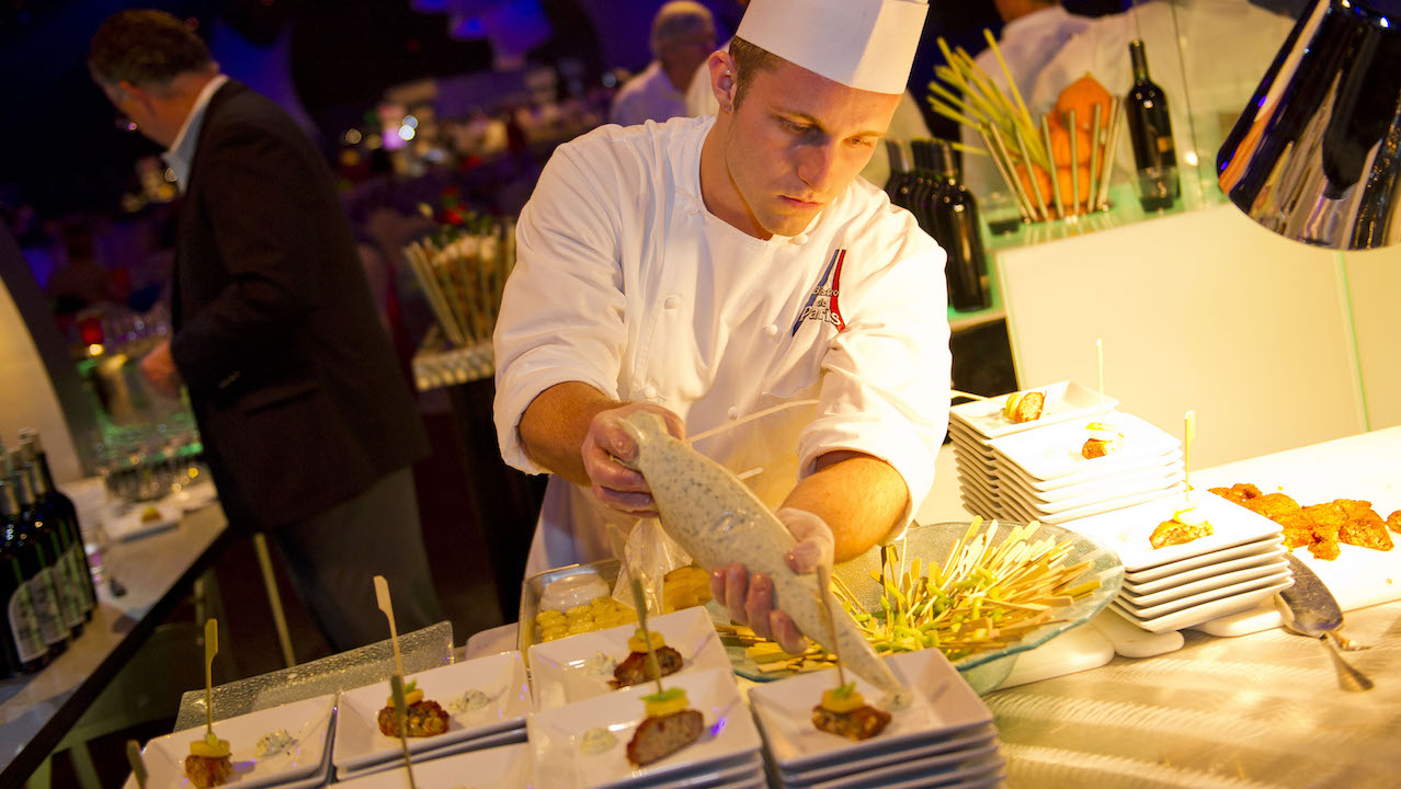 """Chefs from Disney and across the country serve up their finest creations during the Party for the Senses grand tasting experiences during the Epcot International Food & Wine Festival. Each event, held at the park's World Showplace pavilion in Future World, promises an evening of exotic taste treats by Disney and celebrity chefs; wines, beers and other beverages from around the world; plus breathtaking acts by Cirque du Soleil """"La Nouba."""" (Matt Stroshane, photographer)"""
